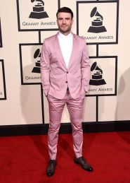 Country singer Sam Hunt caught everyone's eye in this pink suit from Dolce & Gabbana. (Photo: Jordan Strauss/Invision/AP)